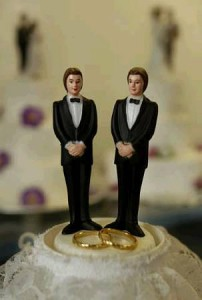 male dolls on a cake