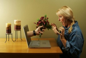 a woman with flower in her laptop