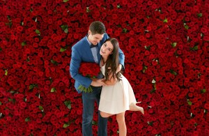 a couple with roses background